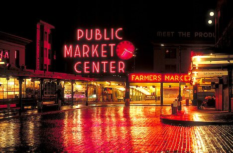 Colorful lights reflect at Pikes Place Market Seattle